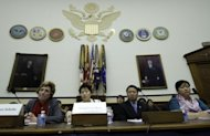 Songhwa Han (2nd L), former North Korean refugee detained in China, repatriated to North Korea, and detained there and Jinhye Jo (R), who suffered the same fate, testify before the US House Foreign Affairs Committee Congressional Executive Commission on China, on Capitol Hill In Washington, DC
