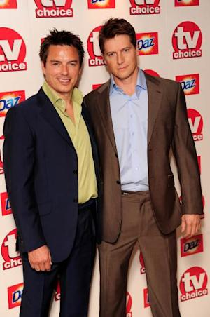 John Barrowman and Scott Gill arrive at the TV Choice Awards 2010 at The Dorchester on September 6, 2010 in London -- Getty Images