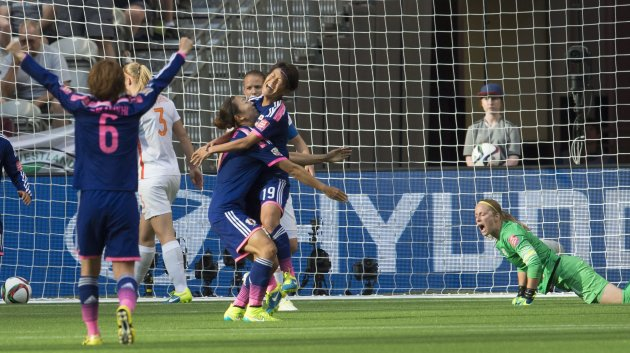 Japan's Saori Ariyoshi celebrates her goal with teamamtes Yuki Ogimi and Mizuho Sakaguchi (6) as Netherlands goalkeeper Loes Geurts gets up during the first half of a round of 16 soccer match at the FIFA Women's World Cup, Tuesday, June 23, 2015, in Vancouver, British Columbia, Canada. (Jonathan Hayward/The Canadian Press via AP)