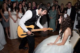 The author being serenaded by her husband on their wedding day!