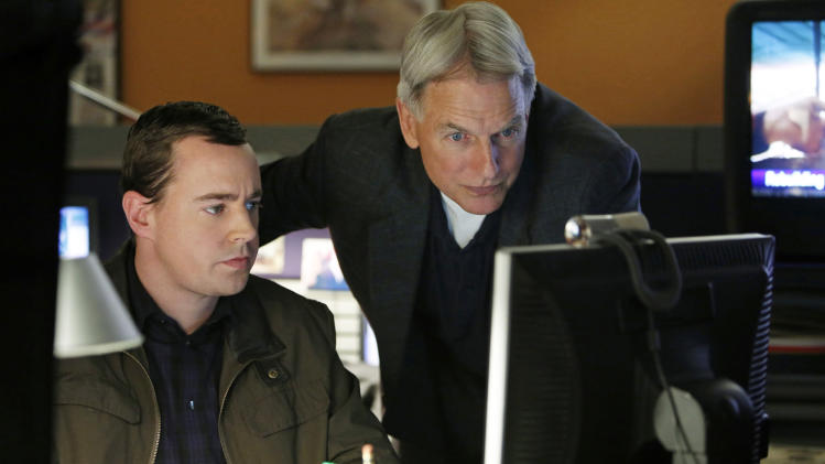 "This undated publicity image released by CBS shows Sean Murray, left, and Mark Harmon in a scene from ""NCIS,"" a long-running series that was one of 18 series renewed by CBS on Wednesday, March 27, 2013. (AP Photo/CBS, Cliff Lipson)"