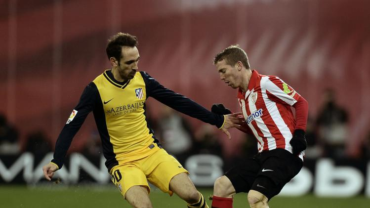 Athletic Bilbao's Muniain fights for the ball with Atletico Madrid's Torres during their Spanish King's Cup soccer match at San Mames stadium in Bilbao