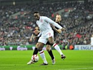 England's Danny Welbeck (L) is challenged by John Heitinga of The Netherlands during an international friendly at Wembley Stadium in London on February 29. Welbeck and Glen Johnson were both passed fit to play at Euro 2012 after being included in England's final 23-man squad for the tournament on Tuesday