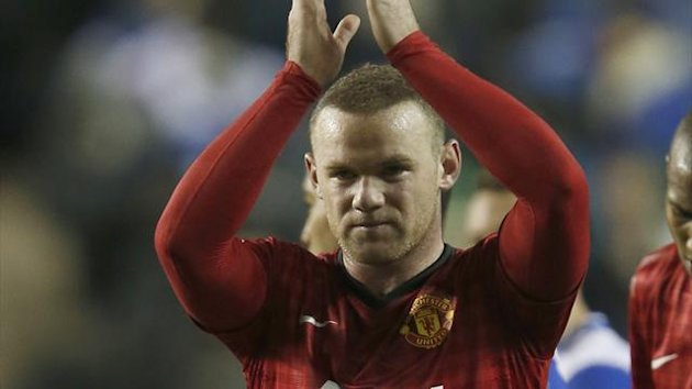 Manchester United's Wayne Rooney salutes the club's fans after their English Premier League match against Reading at the Madejski Stadium in Reading