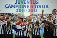 Juventus players celebrate winning the Italian Serie A trophy, the Scudetto, during a ceremony after their match against Atalanta in Juventus stadium in Turin