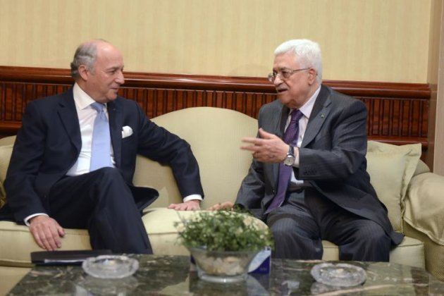 A handout picture released by the Palestinian president's office (PPO) shows Palestinian leader Mahmud Abbas (R) meeting with French Foreign Minister Laurent Fabius ahead of a meeting in Cairo on July 18, 2014