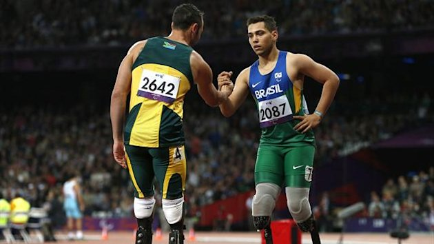 Brazil's Alan Oliveira (R) is congratulated by South Africa's Oscar Pistorius after winning the men's 200m T44 classification at the Olympic Stadium during the London 2012 Paralympic Games (Reuters)