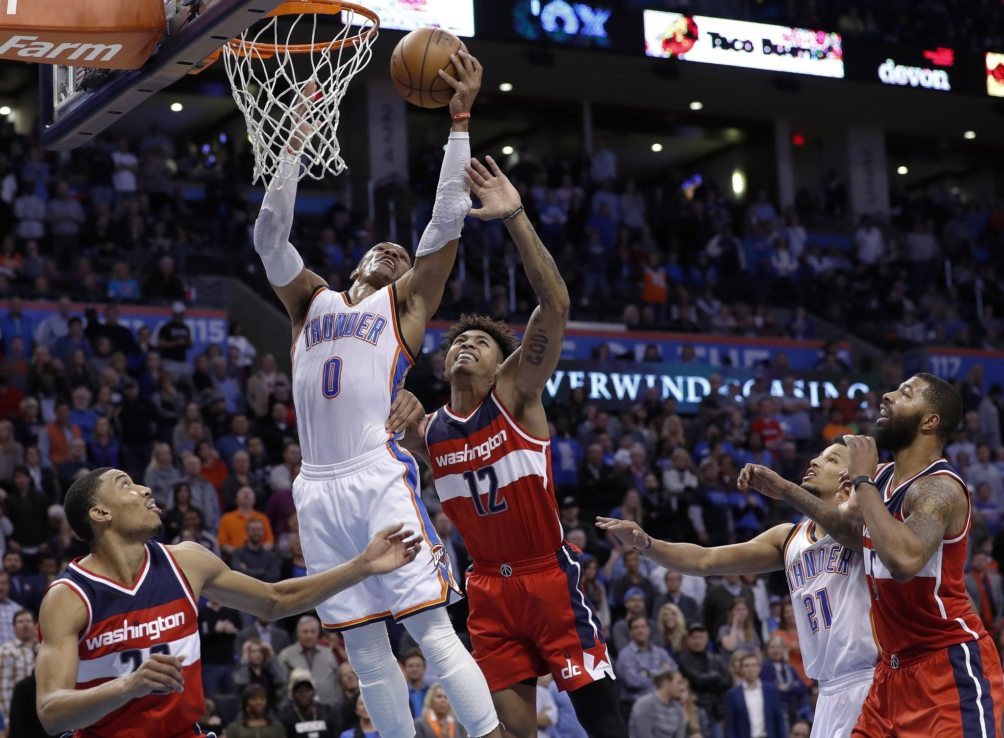 Russell Westbrook skies over the Wizards for one of his 14 rebounds. (AP)