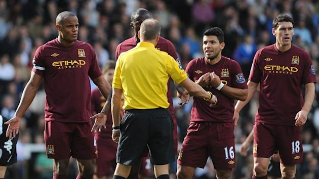 Manchester City's Vincent Kompany and Sergio Kun Aguero appeal to referee Mark Halsey after he awarded a penalty to Fulham (PA Photos)