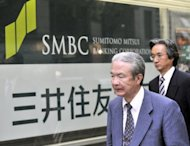 Pedestrians walks past a branch of Sumitomo Mitsui Banking Corp. (SMBC) in Tokyo in 2008. SMBC said Tuesday it will lend technical support to Myanmar's biggest commercial bank as it looks to tap the country as it embarks on reforms that ended decades of isolation