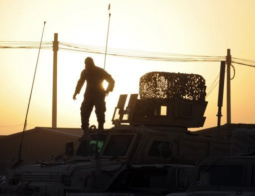 A file photo shows a US Army soldier checking his Mine Resistant Armored Protective Vehicle at the NATO-led International Security Assistance Force military base in southern Kandahar. Up to 16 Afghans were killed or wounded by a rogue American soldier who opened fire on civilians in Kandahar, an Afghan official said.