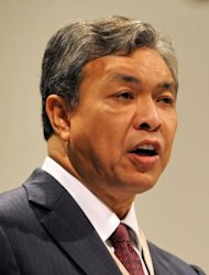 Malaysian Defence Minister Ahmad Zahid Hamidi speaks during the Asia-Pacific security forum in Singapore in 2010. A scandal linking Malaysia's leader, a young woman's murder and alleged kickbacks in a French submarine deal has resurfaced as a potential danger for the government as elections loom