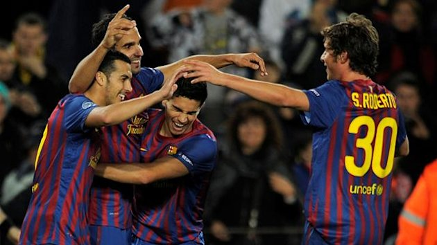 Barcelona's forward Pedro Rodriguez, Barcelona's Martin Montoya, Barcelona's Marc Bartra and Barcelona's Sergi Roberto celebrate after scorimg a goal during the Champions League football match between FC Barcelona and Bate Borissov at the Camp Nou stadium