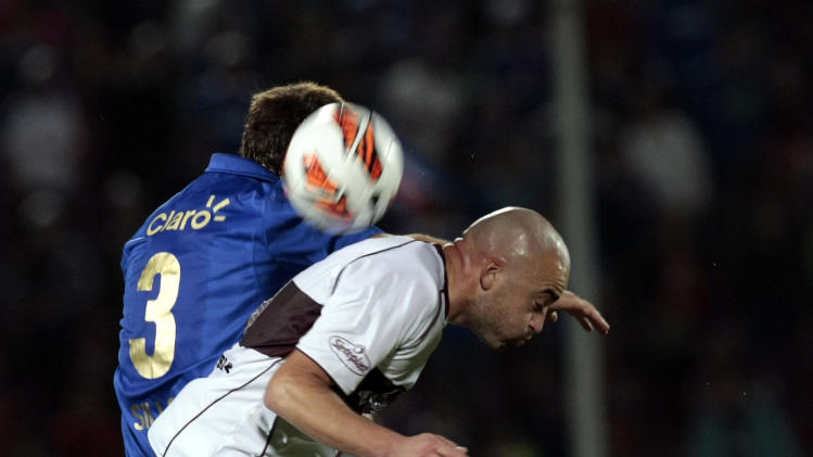 Chile's Universidad de Chile's Juan Ignacio Sills, behind, and Argentina's Lanus Santiago Silva go for the ball at a Copa Sudamericana soccer match in Santiago, Chile, Wednesday, Sept. 25, 2013