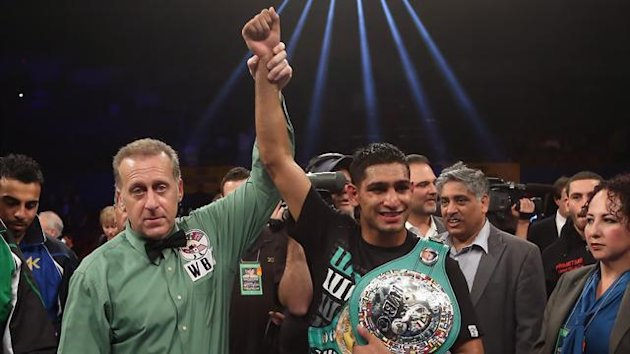 Amir Khan of Great Britain poses with referee Jack Reiss following his Vacant WBC Silver Super Lightweight title fight victory over Carlos Molina at Los Angeles Sports Arena