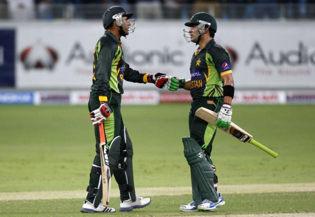 Pakistan's Razzaq and Akmal during their first Twenty20 international cricket match against South Africa in Dubai