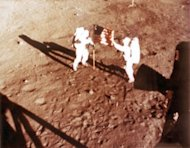"US astronauts Neil Armstrong and ""Buzz"" Aldrin deploy the US flag on the lunar surface during the Apollo 11 lunar landing mission in 1969. Armstrong's 1969 lunar landing marked a pinnacle of US technological achievement, defining what many saw as the American century, but the next person to set foot on the moon will likely be Chinese"