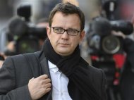 Former News of the World editor Andy Coulson arrives at the Old Bailey courthouse in central London December 18, 2013. REUTERS/Toby Melville