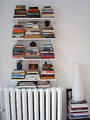 Try stacking books vertically instead of horizontally. It creates a more interesting visual element…