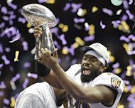Ed Reed of the Baltimore Ravens holds up the Vince Lombardi Trophy following his team's 34-31 victory in Super Bowl XLVII on February 3, 2013 in New Orleans, Louisiana