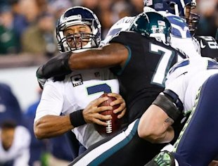 Russell Wilson took some hits, but kept the Seahawks in playoff contention. (Reuters)