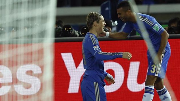 Fernando Torres of Britain's Chelsea celebrates with teammate Ashley Cole after scoring against Mexico's Monterrey during their Club World Cup semi-final match in Yokohama