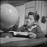 Boy looking at world globe