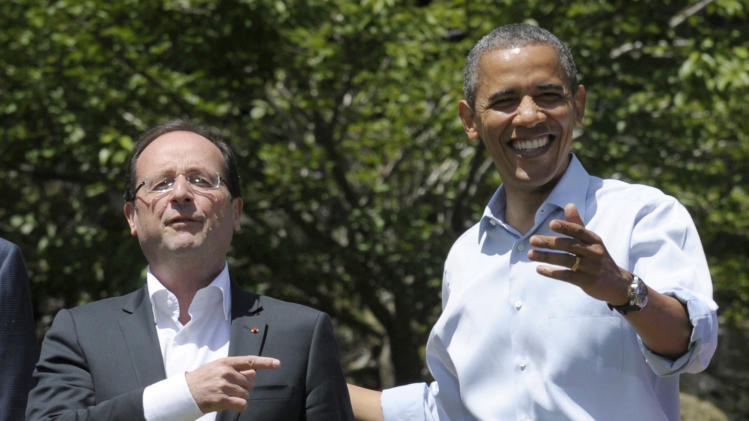 FILE - In this May 19, 2012 file photo, French President Francois Hollande, left, answers a question with President Barack Obama during a photo opportunity at the G-8 Summit at Camp David, Md. France's suddenly single president arrives Monday Feb. 10, 2014 in the U.S. for a state visit, hoping the glaring absence of his first lady won't steal the limelight from his focus on major policy issues with President Barack Obama. Hollande will be highlighting France's shared interests with Washington on issues like Syria's civil war, Iran's nuclear program and terrorism in Africa. (AP Photo/Susan Walsh, File)