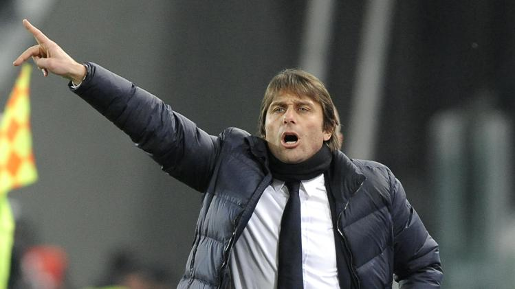 Juventus' coach Conte reacts during their Italian Serie A soccer match against Torino in Turin