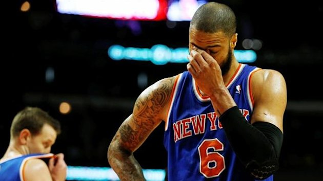 New York Knicks' Tyson Chandler and Steve Novak react to a referee's call against the Chicago Bulls in Chicago (Reuters)