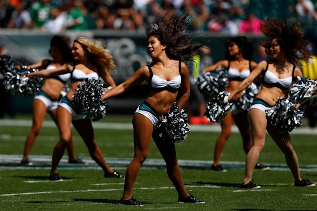 Philadelphia Eagles cheerleaders perform before an NFL football game against the Jacksonville Jaguars, Sunday, Sept. 7, 2014, in Philadelphia. (AP Photo/Michael Perez)