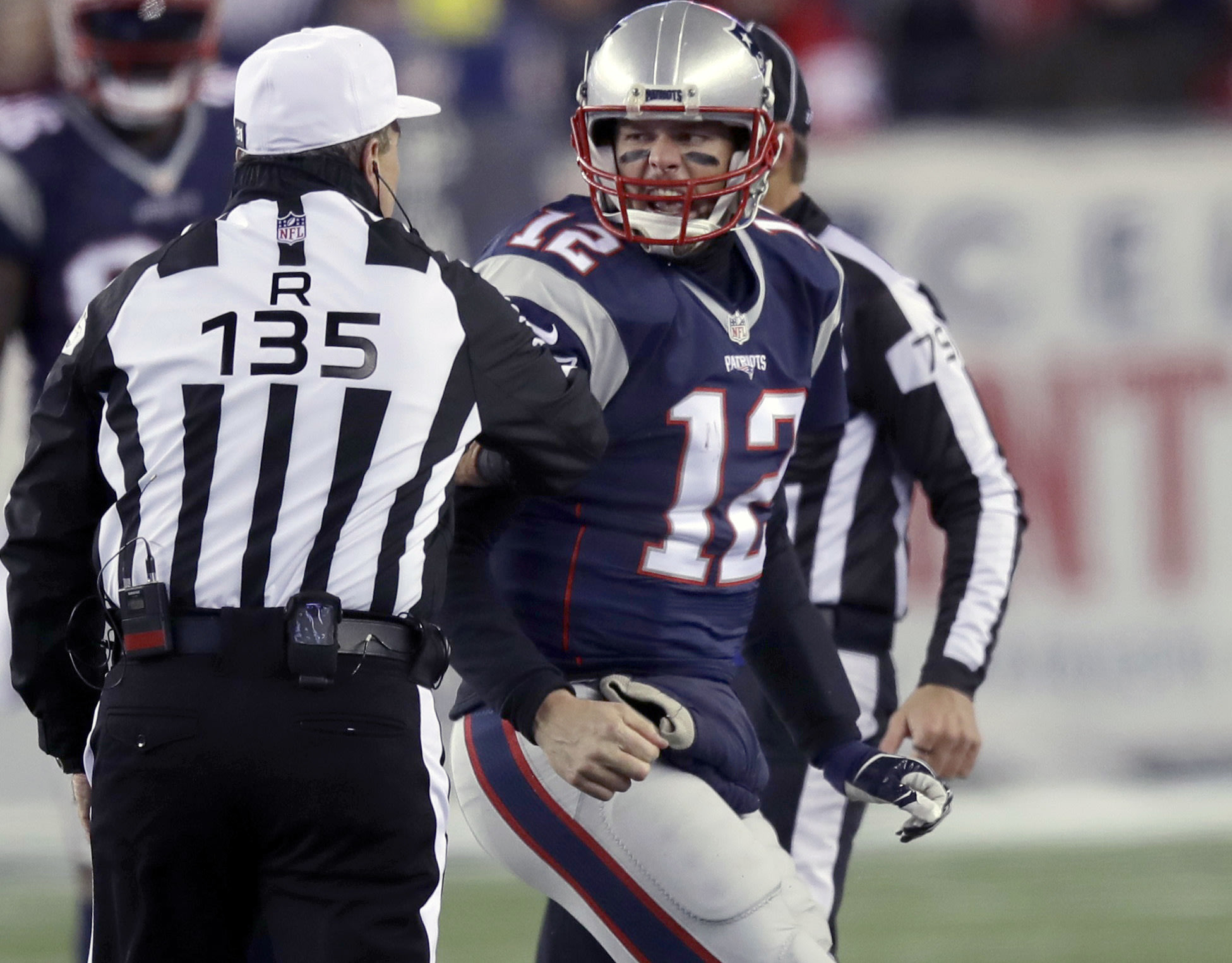 New England Patriots quarterback Tom Brady was not happy with a hit from Jadeveon Clowney. (AP)
