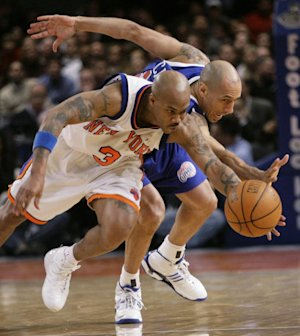 Stephon Marbury, left, and Doug Christie battle for a loose ball in a 2007 game. (AP)