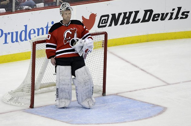 New Jersey Devils goalie Martin Brodeur stands in goal late in the third period of an NHL hockey game against the Boston Bruins in Newark, N.J., Sunda...