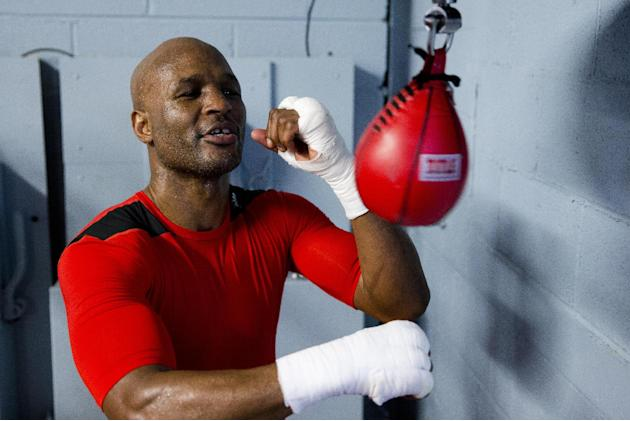 In this April 10, 2014 photo, IBF light heavyweight boxing champion Bernard Hopkins works a speed bag during a media workout in Philadelphia. Hopkins will attempt to become the oldest fighter in boxin