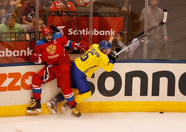 TORONTO, ON - SEPTEMBER 18: Anton Stralman #6 of Team Sweden takes a third-period hit from Alex Ovechkin #8 of Team Russia during the World Cup of Hockey at the Air Canada Center on September 18, 2016 in Toronto, Canada. Team Sweden won the game 2-1. (Photo by Gregory Shamus/Getty Images)