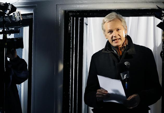 FILE - This is a Thursday, Dec. 20, 2012. file photo of Julian Assange, founder of WikiLeaks as he speaks to the media and members of the public from a balcony at the Ecuadorian Embassy in London. Ass