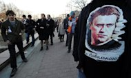 A man wears a T-shirt with a picture of Russian protest leader Alexei Navalny during an opposition rally in his support in Moscow on April 17, 2013. Navalny is accused of causing a loss to the regional government of $500,000 through a timber deal while acting as an advisor