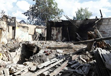 A house damaged by fighting between Ukrainian forces and pro-Russia separatists is seen in the eastern Ukranian city of Slaviansk June 16, 2014. REUTERS/Shamil Zhumatov