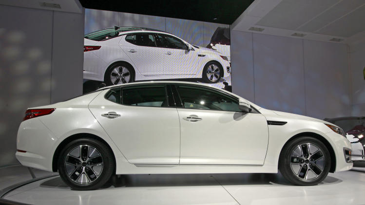 The Kia Optima Hybrid makes its debut at the LA Auto Show Wednesday, Nov. 17, 2010, in Los Angeles.   (AP Photo/Reed Saxon)