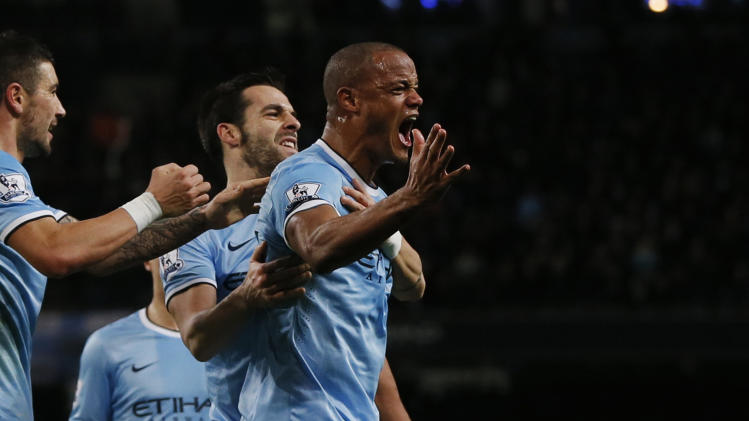 Manchester City's Kompany celebrates with teammates after scoring a goal against Liverpool during their English Premier League soccer match in Manchester