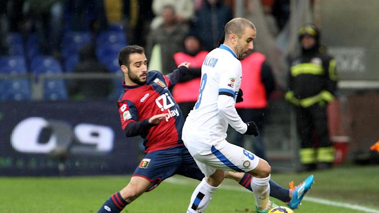 Genoa's Giannis Fetfatzidis of Grecia, left, challenges Inter Milan's Rodrigo Palacio during a Serie A soccer match at Genoa's Luigi Ferraris Stadium, Italy, Sunday, Jan. 19 2014