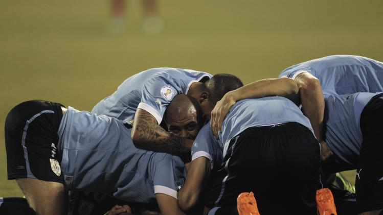Uruguay's players celebrate after Nicolas Lodeiro scored during their World Cup qualifying playoff first leg soccer match against Jordan at Amman International stadium