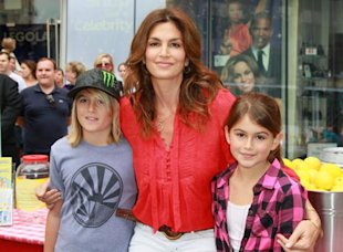 Cindy Crawford with her son Presley Gerber (left) and daughter Kaia Gerber (right) at a fundraiser in 2010.