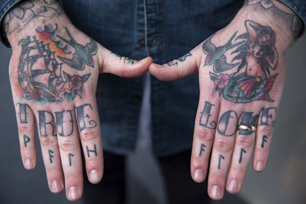 Tattoos are pictured on an attendee's hands during the International London Tattoo Convention in east London, Britain September 26, 2015. REUTERS/Neil Hall