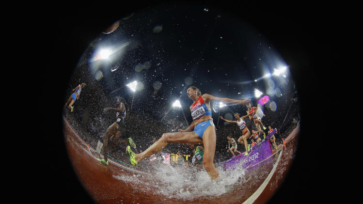 Russia's Gulnara Galkina competes in the women's 3000m steeplechase final at the London 2012 Olympic Games at the Olympic Stadium