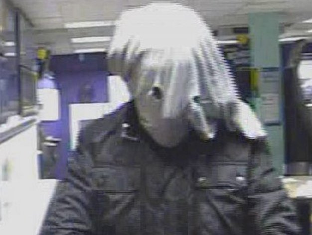 CCTV still of the elephant man masked robber