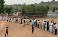 Pakistani voters queue outside a polling station in Islamabad on May 11, 2013. More than 600,000 security personnel have deployed nationwide and around half the estimated 70,000 polling stations have been declared at risk of attack, many of them in insurgency-torn parts of Baluchistan and the northwest.