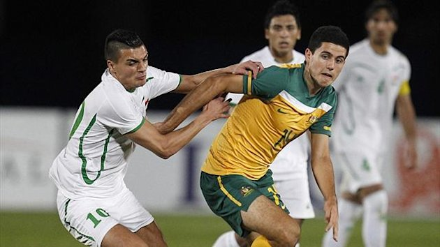 Australia's Tom Rogic fends off Iraq's Ahmed Yaseen during an Olympic Games AFC Asian qualifying match (Reuters)