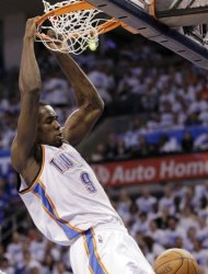 Oklahoma City Thunder forward Serge Ibaka dunks against the San Antonio Spurs during the first half of Game 4 in the NBA basketball playoffs Western Conference finals, Saturday, June 2, 2012, in Oklahoma City. (AP Photo/Sue Ogrocki)